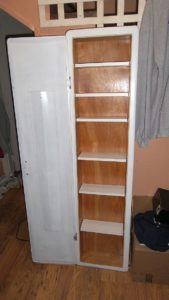 Medicine cabinet made from an old ironing board enclosure.